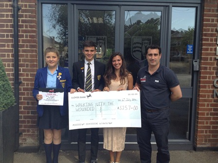 St Johns School present fundraising cheque