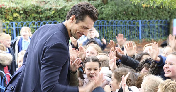 David Gandy high fives at Sunnymeade School