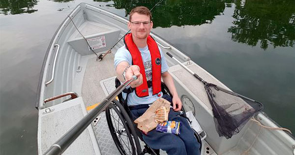 Fly fishing in a fully wheelchair accessible boat, at Hanningfield reservoir in Chelmsford, Essex (Image: Daniel Wilson)