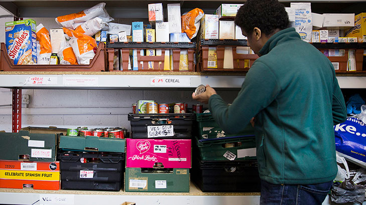 Man stacking shelves in food bank